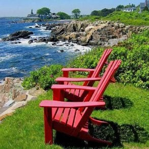Red chairs by the cliffside