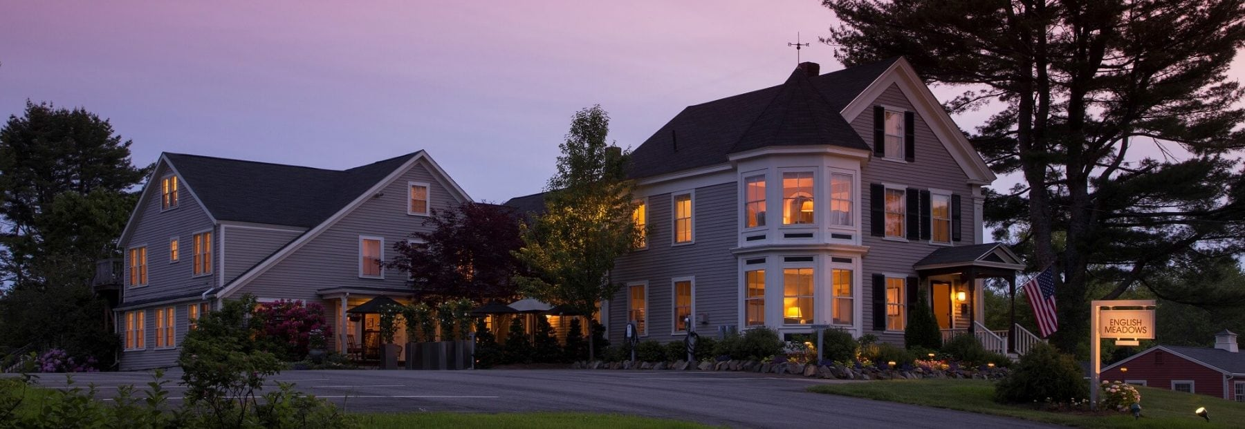 Inn in dusk with a purple sunset