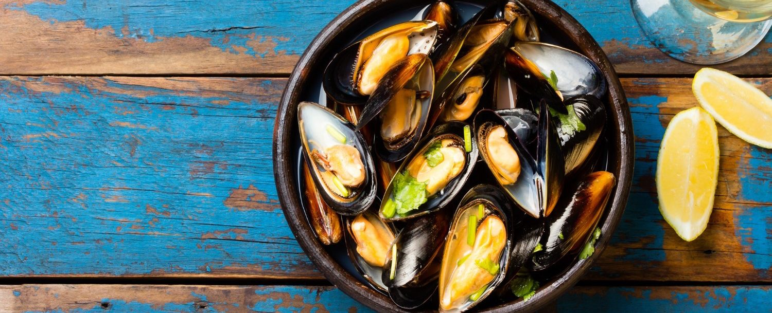 steamed mussels served in clay bowl with white wine